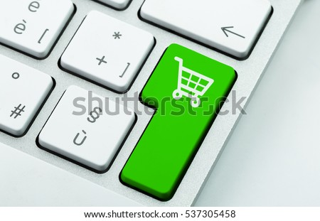 Computer notebook keyboard with icon shopping cart on key. E-commerce concept #537305458
