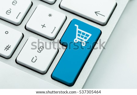 Computer notebook keyboard with icon shopping cart on key. E-commerce concept #537305464