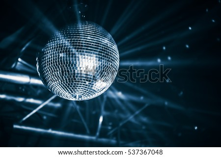 Disco ball with bright rays, blue toned night party background photo Royalty-Free Stock Photo #537367048