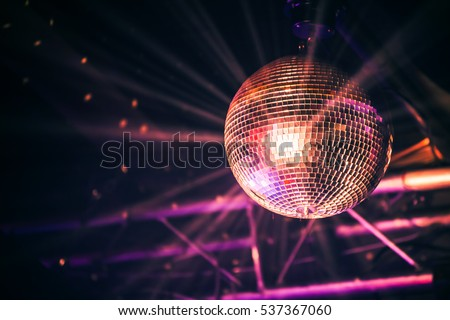 Disco ball with bright rays, night party background photo Royalty-Free Stock Photo #537367060