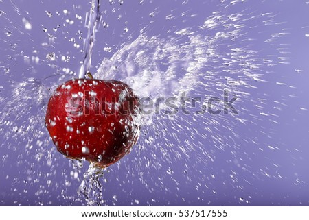 red apple in water drops on background #537517555
