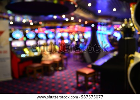 Blurred image of slots machines at the Casino Royalty-Free Stock Photo #537575077