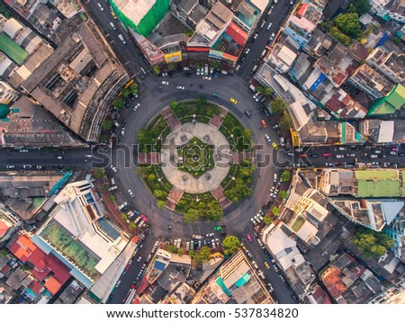 Road roundabout with car lots in the city in Thailand.Sixth Street intersection is beautiful.city scape. Light evening.Aerial view. transportation. #537834820