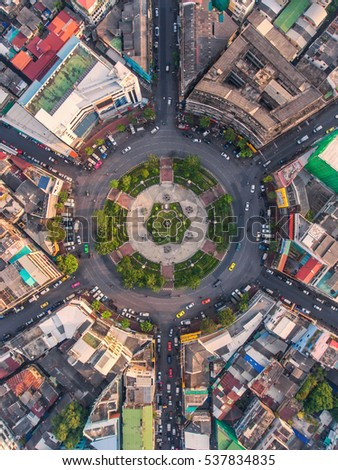 Road roundabout with car lots in the city in Thailand.Sixth Street intersection is beautiful.city scape. Light evening.Aerial view. transportation. #537834835