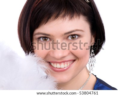 Close-up of beautiful woman with white feather. The angel has perfect eyes and white feathers. Beautiful model with snowy wintry look on white background. #53804761