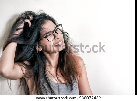 Women have itchy scalp fungus. Royalty-Free Stock Photo #538072489