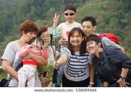 Kundasang Sabah Malaysia - Dec 17, 2016 : Unidentified family taking selfie using handphone at Kudasang Sabah.Kundasang a highland in Borneo is popular destination among tourist. #538089664