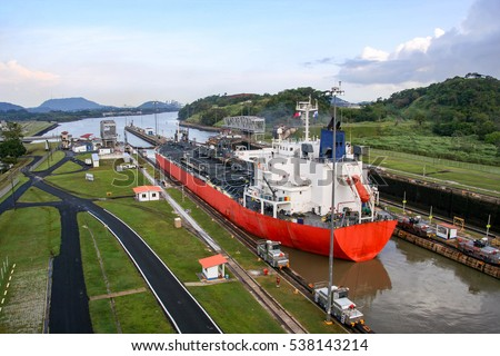The Panama Canal is an artificial 48-mile (77 km) waterway in Panama that connects the Atlantic Ocean with the Pacific Ocean. #538143214