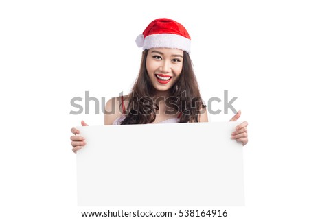Asian Christmas girl with Santa Claus clothes holding blank sign isolated on white background #538164916