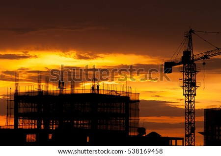 Vietnam workers in construction at central district of Saigon in sunset #538169458