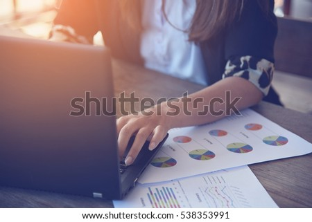 Hands of Businessman working on Laptop Computer with Data Charts #538353991