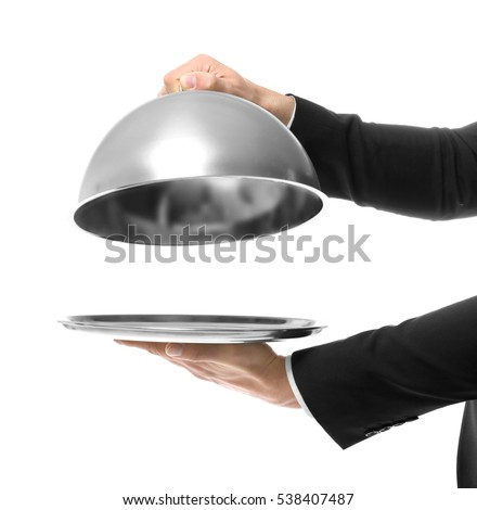 Hands of waiter holding metal tray with cover on white background #538407487