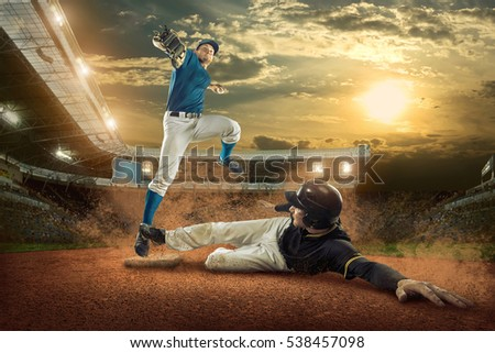 Baseball players in action on the stadium. #538457098