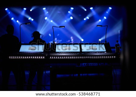 sound mixer console with concert background under blue floodlights. Copy space for advertising text #538468771