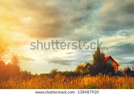 village house on field and cloudy sky autumn background. #538487920