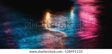 Abstract urban background. Lights and shadows of New York City. NYC streets after rain with reflections on wet asphalt.  Royalty-Free Stock Photo #538491133