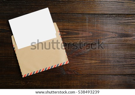 Mockup letter on the wooden table
