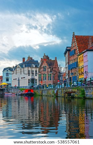 Guild houses on Graslei at Lys River Canal in Ghent in East Flanders, Belgium. People on the background #538557061