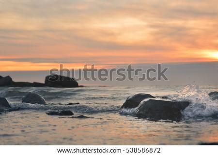 Water splash on sunset background #538586872