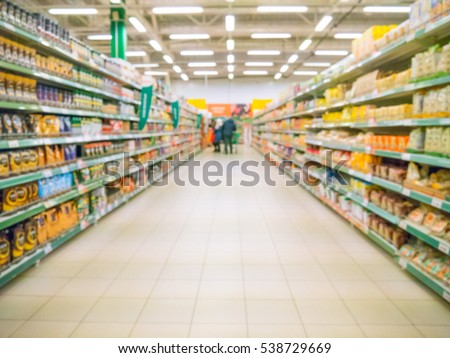 Abstract blurred supermarket aisle with colorful shelves and unrecognizable customers as background #538729669