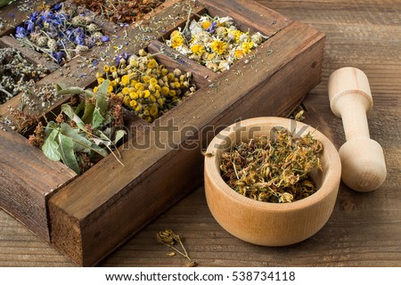 Dried medicinal plant in an old wooden box (chamomile, tansy, linden, St. John's wort, cornflower, mullein, calendula, currant leaves, rosehip). Used for preparation of healthy drinks, decoctions #538734118