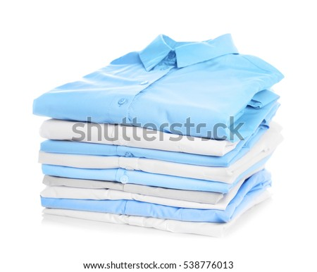 Stack of clothes on white background, closeup #538776013