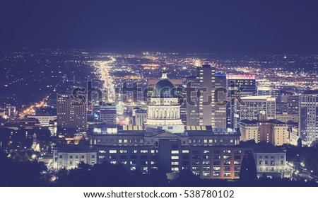 Vintage toned night picture of Salt Lake City downtown, Utah, USA.