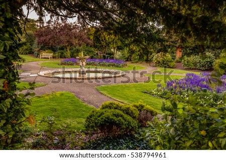 Autumn picture of the fountain in the Rookery in Streatham Common Park in London, UK