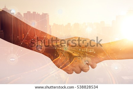 Double exposure of Image of businessmen hand shake, concept of network connection in urban life. Royalty-Free Stock Photo #538828534