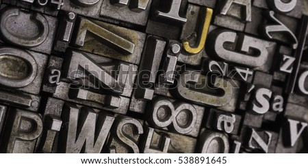 Metal Letterpress Types.  Historical letterpress types, also called as lead letters. These kind of letters were used in Gutenberg presses. These letters were the beginning of typography #538891645