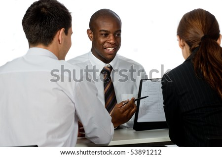 A young and professional businessman having a discussion with two of his colleagues on white background #53891212