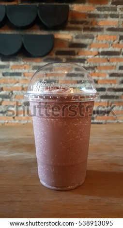 cup of chocolate frappe on table in cafe #538913095