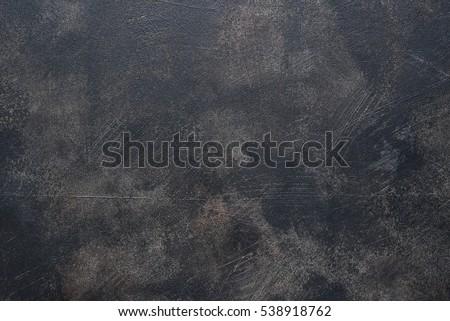 Old rusty metal pan.Black grunge background. Royalty-Free Stock Photo #538918762