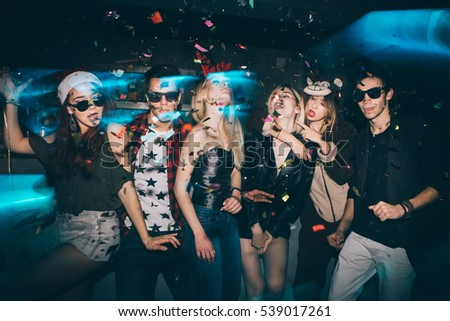 Group of friends at club having fun. New year's party   #539017261
