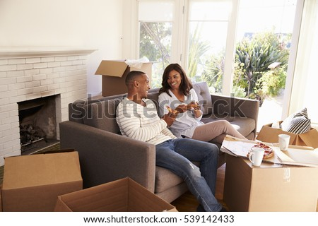Couple Take A Break On Sofa With Pizza On Moving Day #539142433