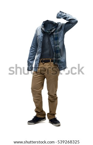 Empty clothes. Checked scarf, denim shirt and brown pants in casual position.  #539268325
