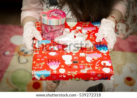 Gifts in the hands of a girl. Beautifully packaged boxes with gifts. Marry Christmas and happy New Year #539272318