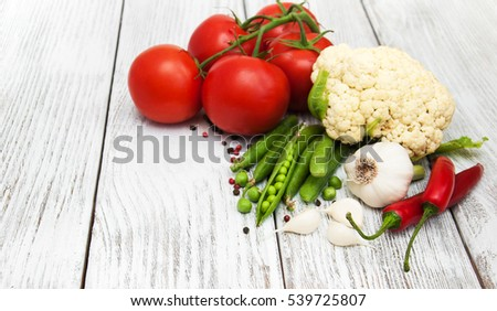 Fresh summer vegetables on a old wooden table #539725807