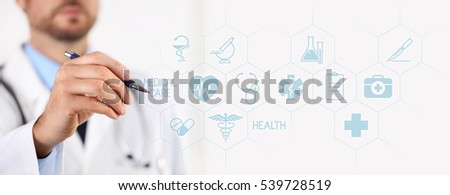 Doctor with a pen pointing medical icons on touchscreen