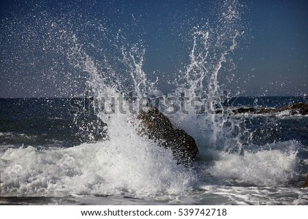 splits waves against rocks in the sea Royalty-Free Stock Photo #539742718