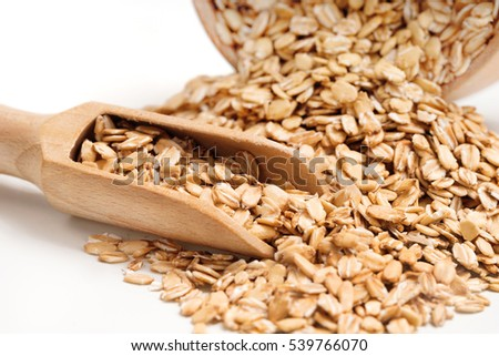 Heap oat flakes and scoop on white background. Healthy food. Close up, high resolution product. #539766070