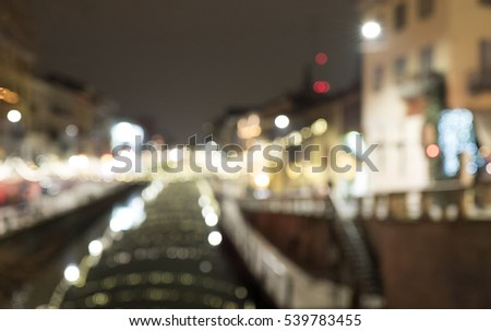 OUT OF FOCUS: christmas ornaments lights on the Navigli canal, in Milan. #539783455
