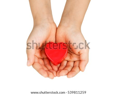 Heart care, medical concept. Heart in the hands of a child. Isolated on white. #539811259