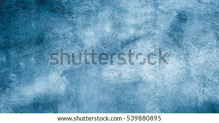 Abstract Grunge Decorative Rough Uneven Navy Blue Stucco Wall Background. Art Texture. Colored Winter Wide Screen Background With Copy Space