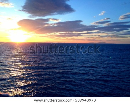 Sunset Over the Ocean #539943973