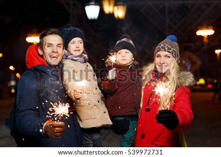 Happy family with burning sparklers #539972731