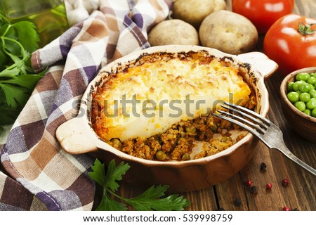 Cottage pie with meat and green peas #539998759