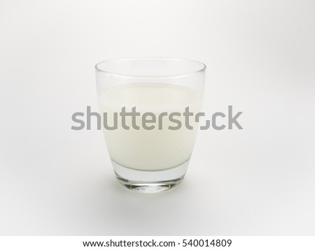 Milk in Glass Cup Isolated on White Background #540014809