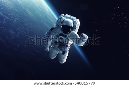 Astronaut at spacewalk. Cosmic art, science fiction wallpaper. Beauty of deep space. Billions of galaxies in the universe. Elements of this image furnished by NASA Royalty-Free Stock Photo #540015799