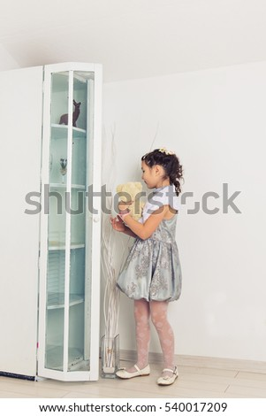 Adorable little girl hugging a teddy bear. Cute baby at home in white room. #540017209